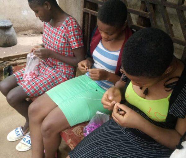 empower her africa - girls working
